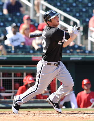GOODYEAR, AZ - MARCH 02:  Brent Morel #22 of the Chicago White Sox watches the ball while running to first base against the Cincinnati Reds during a spring training game at Goodyear Ballpark on March 2, 2011 in Goodyear, Arizona.  (Photo by Norm Hall/Gett