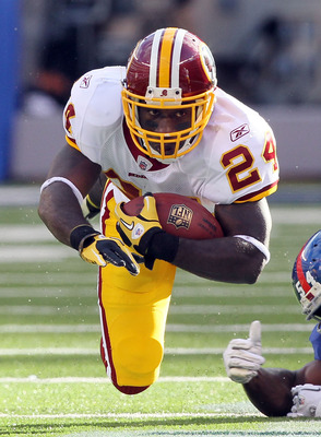 EAST RUTHERFORD, NJ - DECEMBER 05: James Davis #24 of the Washington Redskins carries the ball against the New York Giants on December 5, 2010 at the New Meadowlands Stadium in East Rutherford, New Jersey.  (Photo by Jim McIsaac/Getty Images)