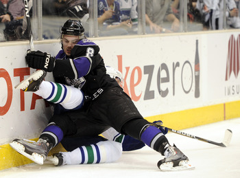 LOS ANGELES, CA - MARCH 05:  Drew Doughty #8 of the Los Angeles Kings knocks over Daniel Sedin #22 of the Vancouver Canucks at the Staples Center on March 5, 2011 in Los Angeles, California.  (Photo by Harry How/Getty Images)