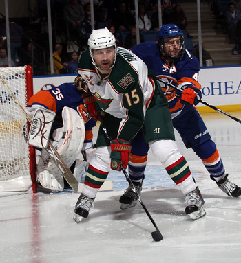 UNIONDALE, NY - MARCH 02: Andrew Brunette #15 of the Minnesota Wild skates against the New York Islanders at the Nassau Coliseum on March 2, 2011 in Uniondale, New York. The Islanders defeated the Wild 4-1.  (Photo by Bruce Bennett/Getty Images)