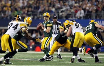 ARLINGTON, TX - FEBRUARY 06:  Quarterback Aaron Rodgers #12 of the Green Bay Packers looks to pass the ball against the Pittsburgh Steelers during Super Bowl XLV at Cowboys Stadium on February 6, 2011 in Arlington, Texas. The Packers won 31-25. (Photo by