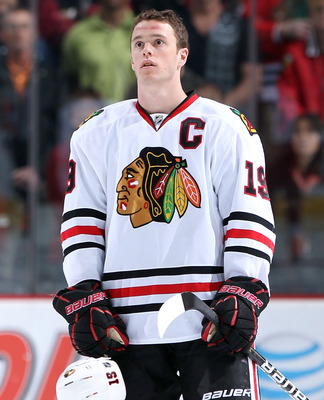 GLENDALE, AZ - MARCH 20:  Jonathan Toews #19 of the Chicago Blackhawks stands attended for the National Anthem before the NHL game against the Phoenix Coyotes at Jobing.com Arena on March 20, 2011 in Glendale, Arizona. The Blackhawks defeated the Coyotes