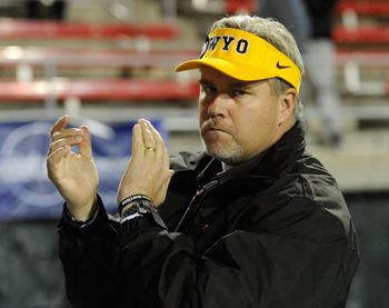 LAS VEGAS - NOVEMBER 13:  Head coach Dave Christensen of the Wyoming Cowboys claps as his team takes the field for a game against the UNLV Rebels at Sam Boyd Stadium November 13, 2010 in Las Vegas, Nevada. UNLV won 42-16.  (Photo by Ethan Miller/Getty Ima