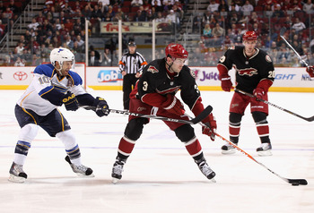 GLENDALE, AZ - MARCH 22:  Keith Yandle #3 of the Phoenix Coyotes skates with the puck under pressure from Andy McDonald #10 of the St. Louis Blues during the second period of the NHL game at Jobing.com Arena on March 22, 2011 in Glendale, Arizona.  (Photo