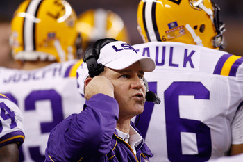 ARLINGTON, TX - JANUARY 07:  Head coach Les Miles of the Louisiana State University Tigers talks wthi his team during a timeout against the Texas A&M Aggies during the AT&T Cotton Bowl at Cowboys Stadium on January 7, 2011 in Arlington, Texas.  (Photo by