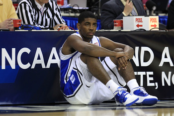 CHARLOTTE, NC - MARCH 20:  Kyrie Irving #1 of the Duke Blue Devils waits to enter the game while taking on the Michigan Wolverines during the third round of the 2011 NCAA men's basketball tournament at Time Warner Cable Arena on March 20, 2011 in Charlott
