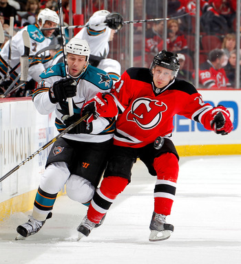 NEWARK, NJ - FEBRUARY 11: Scott Nichol #21 of the San Jose Sharks skates after the puck with Mattias Tedenby #21 of the New Jersey Devils during an NHL hockey game on February 11, 2011 at the Prudential Center in Newark, New Jersey. (Photo by Paul Bereswi