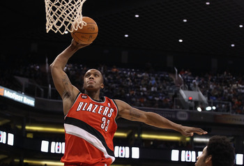 PHOENIX - DECEMBER 10:  Dante Cunningham #33 of the Portland Trail Blazers slam dunks the ball against the Phoenix Suns during the NBA game at US Airways Center on December 10, 2010 in Phoenix, Arizona. The Trail Blazers defeated the Suns 101-94.  NOTE TO