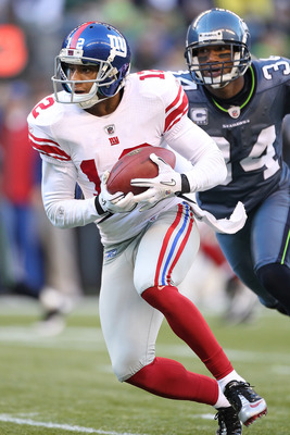SEATTLE - NOVEMBER 07:  Wide receiver Steve Smith #12 of the New York Giants rushes against Roy Lewis #34 of the Seattle Seahawks at Qwest Field on November 7, 2010 in Seattle, Washington. The Giants defeated the Seahawks 41-7. (Photo by Otto Greule Jr/Ge