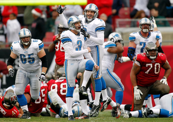 TAMPA, FL - DECEMBER 19:  Kicker Dave Rayner #3 of the Detroit Lions celebrates with holder Nick Harris #2 the winning field goal in overtime against the Tampa Bay Buccaneers during the game at Raymond James Stadium on December 19, 2010 in Tampa, Florida.