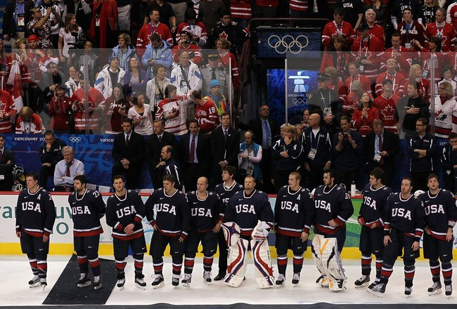 VANCOUVER, BC - FEBRUARY 28:  Dejected Team USA players wait to receive their silver medals following their 3-2 overtime defeat in the ice hockey men's gold medal game between USA and Canada on day 17 of the Vancouver 2010 Winter Olympics at Canada Hockey