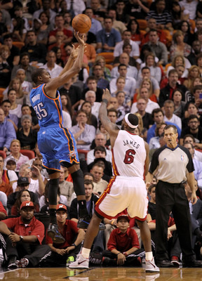 MIAMI, FL - MARCH 16:  Kevin Durant #35  of the the Oklahoma City Thunder shoots over LeBron James #6 of the Miami Heat during a game at American Airlines Arena on March 16, 2011 in Miami, Florida. NOTE TO USER: User expressly acknowledges and agrees that