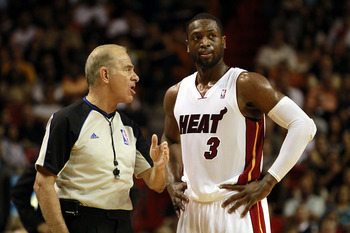 MIAMI, FL - MARCH 19:  Guard Dwyane Wade #3 of the Miami Heat chats with the referee against the Denver Nuggets at American Airlines Arena on March 19, 2011 in Miami, Florida. The Heat defeated the Nuggets 103-98. NOTE TO USER: User expressly acknowledges