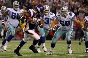 MINNEAPOLIS - OCTOBER 17:  E.J. Henderson #56 of the Minnesota Vikings intercepts a pass against the Dallas Cowboys during the game at Mall of America Field on October 17, 2010 in Minneapolis, Minnesota. The Vikings defeated the Cowboys 24-21.  (Photo by