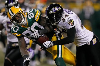 GREEN BAY, WI - DECEMBER 07: Domonique Foxworth #24 of the Baltimore Ravens hits Donald Driver #80 of the Green Bay Packers at Lambeau Field on December 7, 2009 in Green Bay, Wisconsin. The Packers defeated the Ravens 27-17. (Photo by Jonathan Daniel/Gett