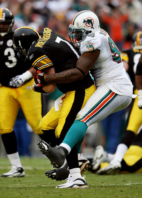 MIAMI - JANUARY 03:  Quarterback Ben Roethlisberger #7 of the Pittsburgh Steelers is sacked by defensive end Randy Starks #94 of the Miami Dolphins at Land Shark Stadium on January 3, 2010 in Miami, Florida. The Steelers defeated the Dolphins 30-24.  (Pho