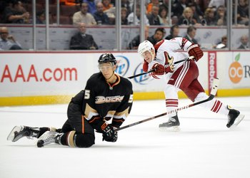 ANAHEIM, CA - SEPTEMBER 16:  Chad Kolarik #52 of the Phoenix Coyotes shoots as Luca Sbisa #5 attempts a block during the game at Honda Center on September 16, 2009 in Anaheim, California.  (Photo by Harry How/Getty Images)