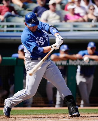 MESA, AZ - MARCH 09: Billy Butler #16 of the Kansas City Royals hits a one-run single against the Chicago Cubs during the spring training baseball game at HoHoKam Stadium on March 9, 2011 in Mesa, Arizona.  (Photo by Kevork Djansezian/Getty Images)