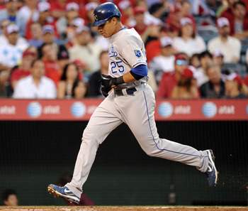 ANAHEIM, CA - AUGUST 10: Kila Ka'aihue #25 of the Kansas City Royals scores a run for a 1-1 tie with the Los Angeles Angels during the second inning at Angel Stadium on August 10, 2010 in Anaheim, California.  (Photo by Harry How/Getty Images)