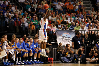 TAMPA, FL - MARCH 17:  Erving Walker #11 of the Florida Gators attempts a shot against the UC Santa Barbara Gauchos during the second round of the 2011 NCAA men's basketball tournament at St. Pete Times Forum on March 17, 2011 in Tampa, Florida. Florida w