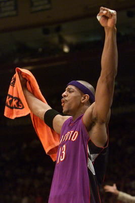 4 May 2001:  Jerome Williams #13 of the Toronto Raptors celebrates in game four of round one of the NBA playoffs against the New York Knicks at Madison Square Garden in New York, New York.  The Raptors won 93-89 to take the series 3-2.  DIGITAL IMAGE.  Ma