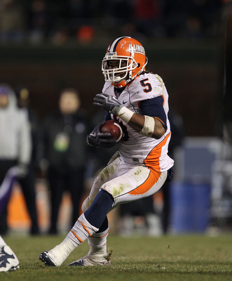 CHICAGO, IL - NOVEMBER 20: Mikel Leshoure #5 of the Illinois Fighting Illini runs against the Northwestern Wildcats closes in during a game played at Wrigley Field on November 20, 2010 in Chicago, Illinois. Illinois defeated Northwestern 48-27. (Photo by