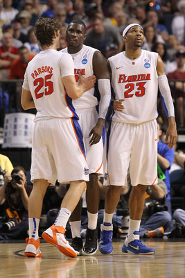 TAMPA, FL - MARCH 19:  (L-R) Chandler Parsons #25 , Vernon Macklin #32 and Alex Tyus #23 of the Florida Gators stand on court against the UCLA Bruins during the third round of the 2011 NCAA men's basketball tournament at St. Pete Times Forum on March 19,
