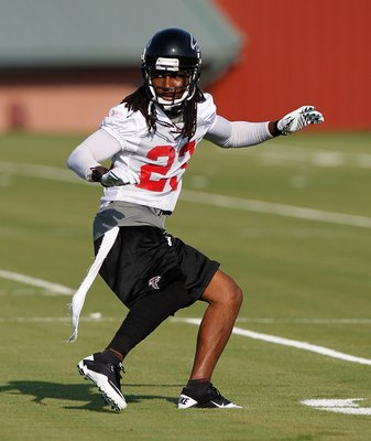 FLOWERY BRANCH, GA - JULY 30:  Dunta Robinson #23 of the Atlanta Falcons runs drills during opening day of training camp on July 30, 2010 at the Falcons Training Complex in Flowery Branch, Georgia.  (Photo by Kevin C. Cox/Getty Images)