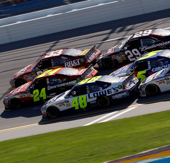 TALLADEGA, AL - APRIL 17:  Clint Bowyer, driver of the #33 BB&T Chevrolet, Jeff Gordon, driver of the #24 Drive to End Hunger/AARP Chevrolet, and Jimmie Johnson, driver of the #48 Lowe's Chevrolet, lead Kevin Harvick, driver of the #29 Budweiser Chevrolet