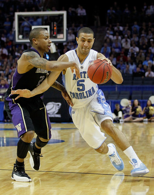 CHARLOTTE, NC - MARCH 20:  Kendall Marshall #5 of the North Carolina Tar Heels drives on Isaiah Thomas #2 of the Washington Huskies during the third round of the 2011 NCAA men's basketball tournament at Time Warner Cable Arena on March 20, 2011 in Charlot