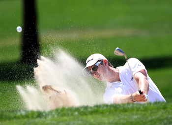 PALM HARBOR, FL - MARCH 20:  Justin Rose of England plays a shot on the 2nd hole during the final round of the Transitions Championship at Innisbrook Resort and Golf Club on March 20, 2011 in Palm Harbor, Florida.  (Photo by Sam Greenwood/Getty Images)