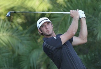DORAL, FL - MARCH 13:  Dustin Johnson watches a shot during the final round of the 2011 WGC- Cadillac Championship at the TPC Blue Monster at the Doral Golf Resort and Spa on March 13, 2011 in Doral, Florida.  (Photo by Sam Greenwood/Getty Images)