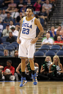 TAMPA, FL - MARCH 17:  Tyler Honeycutt #23 of the UCLA Bruins celebrates a play in the second half against the Michigan State Spartans during the second round of the 2011 NCAA men's basketball tournament at St. Pete Times Forum on March 17, 2011 in Tampa,