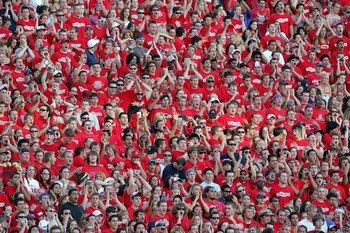TUCSON, AZ - SEPTEMBER 23:  The Zona Zoo, the student section for the Arizona Wildcats, cheers on their team against the USC Trojans during the game at Arizona Stadium on September 23, 2006 in Tucson, Arizona.  (Photo by Lisa Blumenfeld/Getty Images)