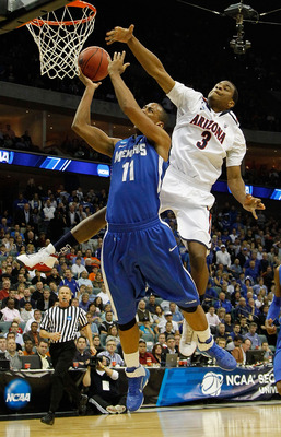TULSA, OK - MARCH 18:  Kevin Parrom #3 of the Arizona Wildcats looks to block a shot by Wesley Witherspoon #11 of the Memphis Tigers during the second round of the 2011 NCAA men's basketball tournament at BOK Center on March 18, 2011 in Tulsa, Oklahoma.