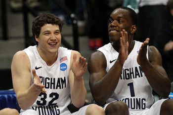 DENVER, CO - MARCH 19:  Jimmer Fredette #32 and Charles Abouo #1 of the Brigham Young Cougars celebrates on the bench towards the end of the game against the Gonzaga Bulldogs during the third round of the 2011 NCAA men's basketball tournament at Pepsi Cen