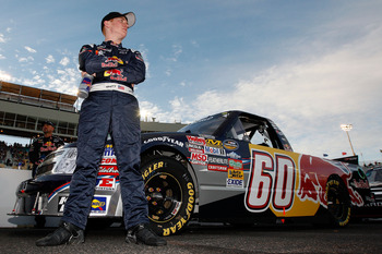 AVONDALE, AZ - FEBRUARY 25:  Cole Whitt, driver of the #60 Red Bull Chevrolet, stands by his truck prior to the NASCAR Camping World Truck Series Lucas Oil 150 at Phoenix International Raceway on February 25, 2011 in Avondale, Arizona.  (Photo by Chris Gr