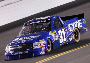DAYTONA BEACH, FL - FEBRUARY 18:  James Buescher, driver of the #31 Exide Batteries Chevrolet, races during the NASCAR Camping World Truck Series NextEra Energy Resources 250 at Daytona International Speedway on February 18, 2011 in Daytona Beach, Florida