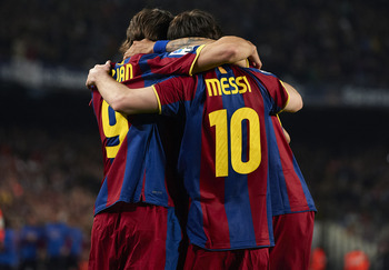 BARCELONA, SPAIN - MARCH 19:  Barcelona players celebrate after team mate Daniel Alves scored the opening goal during the La Liga match between Barcelona and Getafe at Camp Nou on March 19, 2011 in Barcelona, Spain.  (Photo by Manuel Queimadelos Alonso/Ge