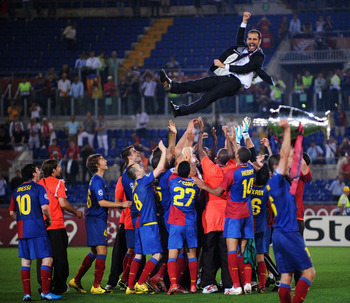 ROME - MAY 27:  Josep Guardiola coach of Barcelona is  thrown into the air by his players as they celebrate winning the UEFA Champions League Final match between Manchester United and Barcelona at the Stadio Olimpico on May 27, 2009 in Rome, Italy.  (Phot