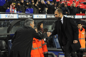BARCELONA, SPAIN - NOVEMBER 29:  Head coach Jose Mourinho of Real Madrid (L) and head coach Josep Guardiola of Barcelona shake hands prior to the La Liga match between Barcelona and Real Madrid at the Camp Nou Stadium on November 29, 2010 in Barcelona, Sp