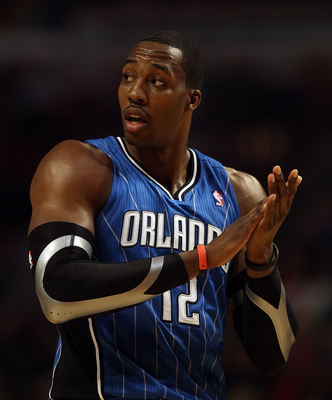 CHICAGO, IL - JANUARY 28: Dwight Howard #12 of the Orlando Magic prepares to shoot a free-throw on his way to a game-high 40 points against the Chicago Bulls at the United Center on January 28, 2011 in Chicago, Illinois. The Bulls defeated the Magic 99-90