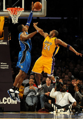 LOS ANGELES, CA - JANUARY 18:  Dwight Howard #12 of the Orlando Magic blocks the shot by Kobe Bryant #24 of the Los Angeles Lakers in the fourth quarter during the game on January 18, 2010 at Staples Center in Los Angeles, California. NOTE TO USER: User e