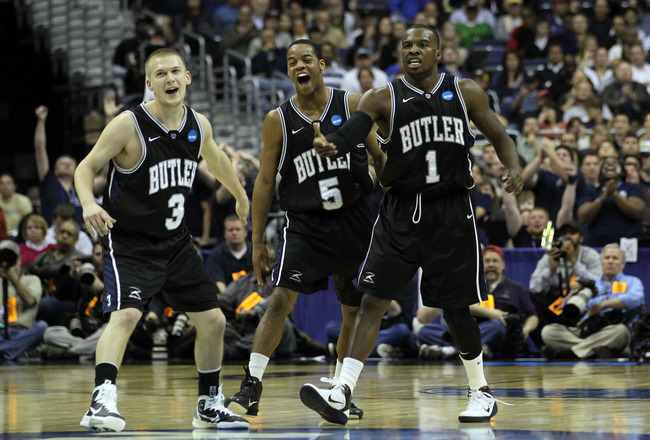WASHINGTON - MARCH 19:  Zach Hahn #3, Ronald Nored #5 and Shelvin Mack #1 of the Butler Bulldogs celebrate during their game against the Pittsburgh Panthers during the third round of the 2011 NCAA men's basketball tournament at Verizon Center on March 19,