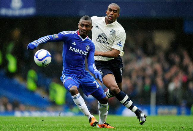 LONDON, ENGLAND - FEBRUARY 19:  Salomon Kalou of Chelsea is challenged by Sylvain Distin of Everton during the FA Cup sponsored by E.ON 4th round replay match between Chelsea and Everton at Stamford Bridge on February 19, 2011 in London, England.  (Photo