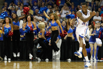TULSA, OK - MARCH 20:  Tyshawn Taylor #10 of the Kansas Jayhawks reacts to a play during their 59-73 win over the Illinois Fighting Illini in the third round of the 2011 NCAA men's basketball tournament at BOK Center on March 20, 2011 in Tulsa, Oklahoma.