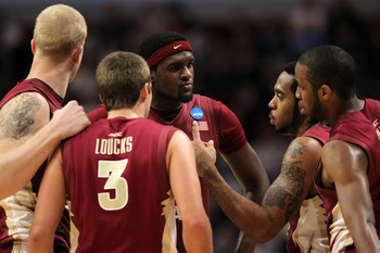 CHICAGO, IL - MARCH 20:  Chris Singleton #31, Luke Loucks #3, Derwin Kitchen #22, Jon Kreft #50 and Michael Snaer #21 of the Florida State Seminoles talk in the second half against the Notre Dame Fighting Irish during the third round of the 2011 NCAA men'