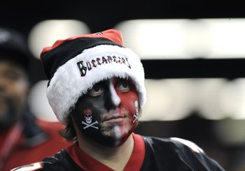ATLANTA - DECEMBER 14: A fan of the Atlanta Falcons watches play  against the Tampa Bay Buccaneers  at the Georgia Dome on December 14, 2008 in Atlanta, Georgia.  (Photo by Al Messerschmidt/Getty Images)