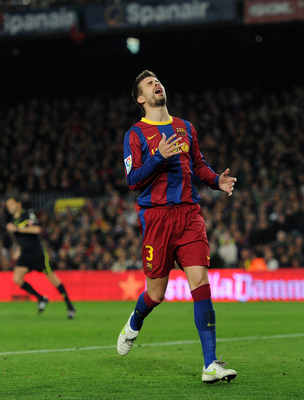 BARCELONA, SPAIN - MARCH 05:  Gerard Pique of Barcelona reacts as he fails to score during the la Liga match between Barcelona and Real Zaragoza at the Camp Nou stadium on March 5, 2011 in Barcelona, Spain.  (Photo by Jasper Juinen/Getty Images)