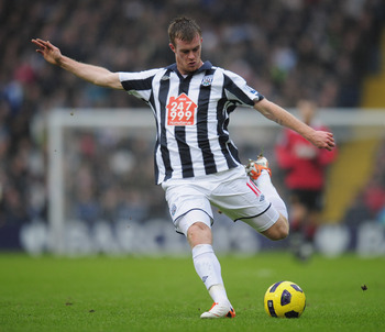 WEST BROMWICH, ENGLAND - JANUARY 01:  Chris Brunt of West Bromich Albion fires in a shot during the Barclays Premier League match between West Bromich Albion and Manchester United at The Hawthorns on January 1, 2011 in West Bromwich, England.  (Photo by S